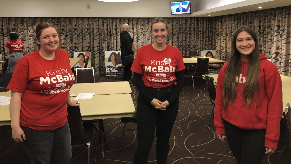 Emma Hogan, Manu Risoldi and Natalie Simonovski celebrate in a COVID safe way, after a hard-fought campaign at the Labor Party Eden-Monaro function at the Sapphire Club in Merimbula. Picture: Elliot Williams